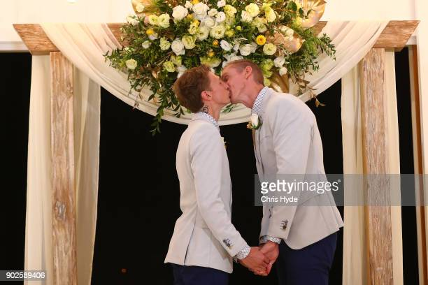 Craig Burns and Luke Sullivan kiss during the wedding ceremony at Summergrove Estate on January 9 2018 in Gold Coast Australia Couples across...
