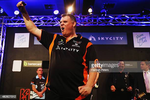 Craig Caldwell celebrates after winning the Super League Darts Final between Warren Parry and Craig Caldwell at Sky City on August 1 2015 in Auckland...