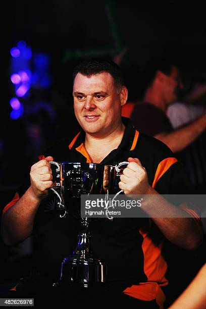 Craig Caldwell celebrates with the trophy after winning the Super League Darts Final between Warren Parry and Craig Caldwell at Sky City on August 1...