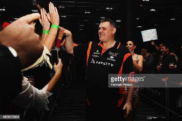 Craig Caldwell is welcomed by fans ahead of the Super League Darts semi final match between Craig Caldwell and Peter Hunt at Sky City on August 1...