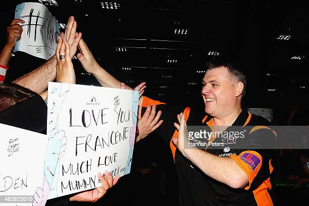 Craig Caldwell is welcomed by fans ahead of the Super League Darts Final between Warren Parry and Craig Caldwell at Sky City on August 1 2015 in...