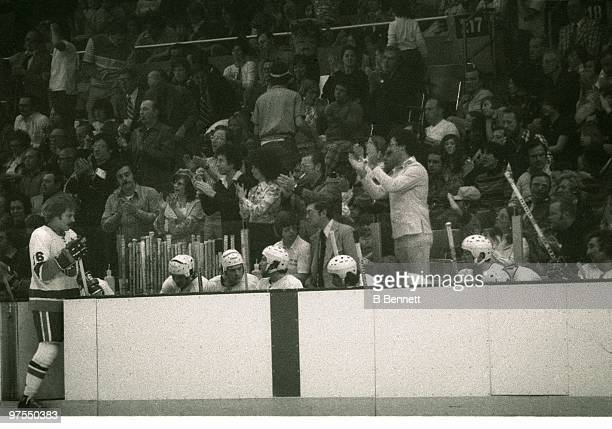 Craig Cameron of the New York Islanders goes to the bench as fans cheer in the background while the Isles play the Pittsburgh Penguins during Game 4...