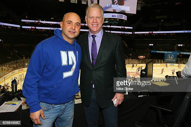 Craig Carton and Boomer Esiason pos for a photo priro to calling the game between the New York Islanders and the Pittsburgh Penguins on WFAN at the...