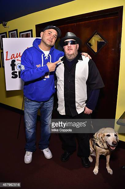Craig Carton Brian Fischler and the dog Nash attend the 2014 Laugh For Sight Benefit at Gotham Comedy Club on October 27 2014 in New York City