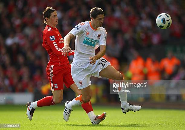 Craig Cathcart of Blackpool holds off a challenge from Fernando Torres of Liverpool during the Barclays Premier League match between Liverpool and...