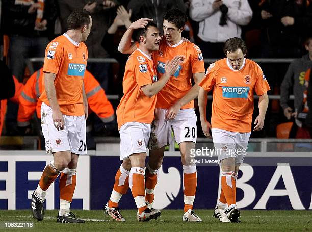 Craig Cathcart of Blackpool is congratulated by his team mates after scoring the opening goal during the Barclays Premier League match between...