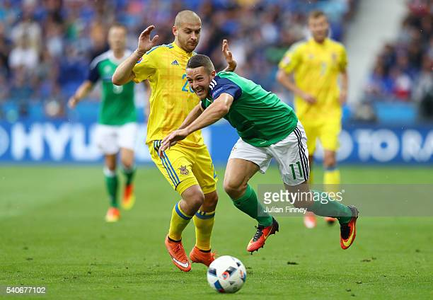 Craig Cathcart of Northern Ireland and Yaroslav Rakitskiy of Ukraine compete for the ball during the UEFA EURO 2016 Group C match between Ukraine and...