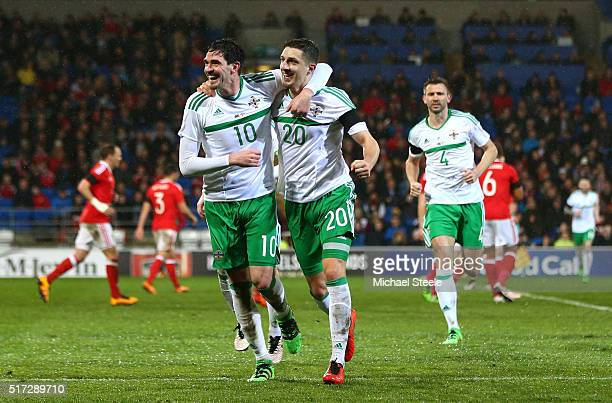 Craig Cathcart of Northern Ireland celebrates with teammate Kyle Rafferty after scoring the opening goal during the international friendly match...