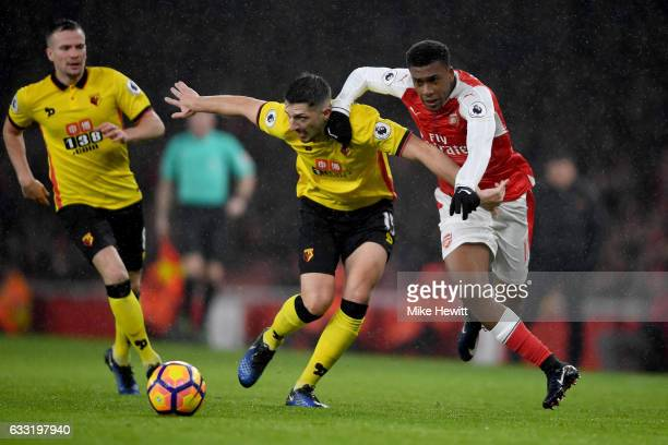 Craig Cathcart of Watford and Alex Iwobi of Arsenal compete for the ball during the Premier League match between Arsenal and Watford at Emirates...