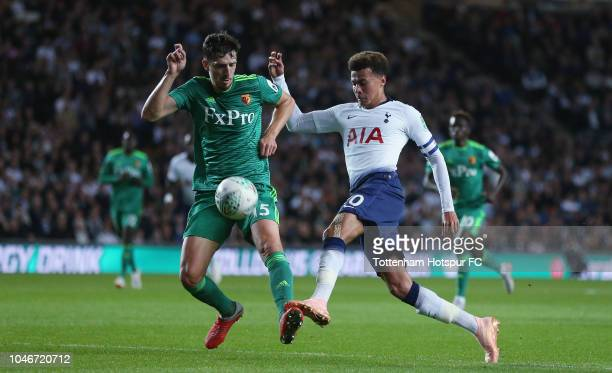 Craig Cathcart of Watford and Dele Alli of Tottenham Hotspur during the Carabao Cup Third Round match between Tottenham Hotspur and Watford at...