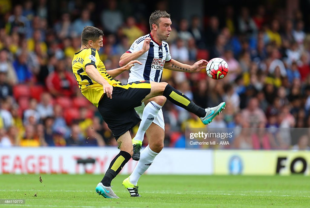 Craig Cathcart of Watford and Rickie Lambert of West Bromwich Albion during the Barclays premier League match between Watford and West Bromwich Albion at Vicarage Road on August 15, 2015 in Watford, England.