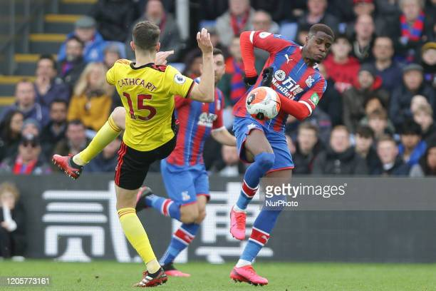 Craig Cathcart of Watford and Wilfried Zaha of Crystal Palace battling for possession during the Premier League match between Crystal Palace and...