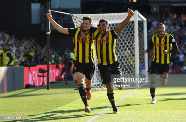 Craig Cathcart of Watford celebrates after scoring his team's second goal with Troy Deeney of Watford during the Premier League match between Watford...
