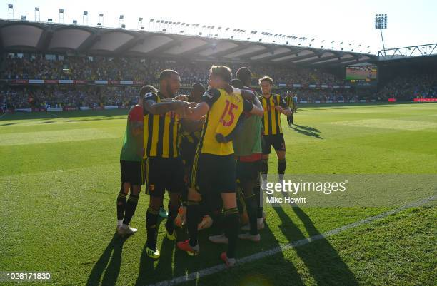 Craig Cathcart of Watford celebrates after scoring his team's second goal with team mates during the Premier League match between Watford FC and...