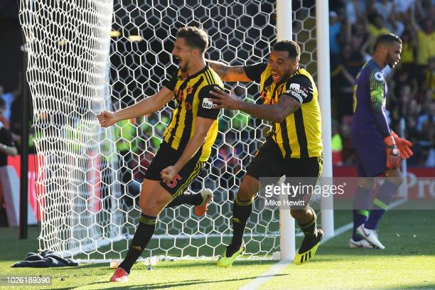 Craig Cathcart of Watford celebrates with his captain Troy Deeney after scoring the winner during the Premier League match between Watford FC and...