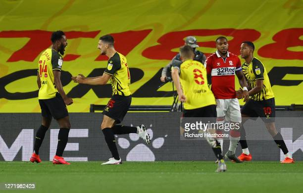 Craig Cathcart of Watford celebrates with teammates after scoring his team's first goal during the Sky Bet Championship match between Watford and...
