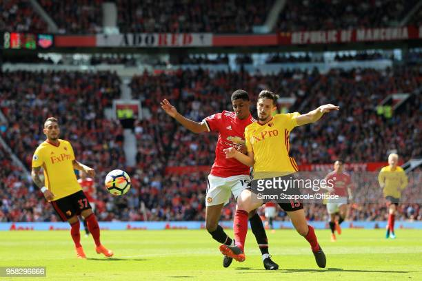 Craig Cathcart of Watford tackles Marcus Rashford of Man Utd during the Premier League match between Manchester United and Watford at Old Trafford on...
