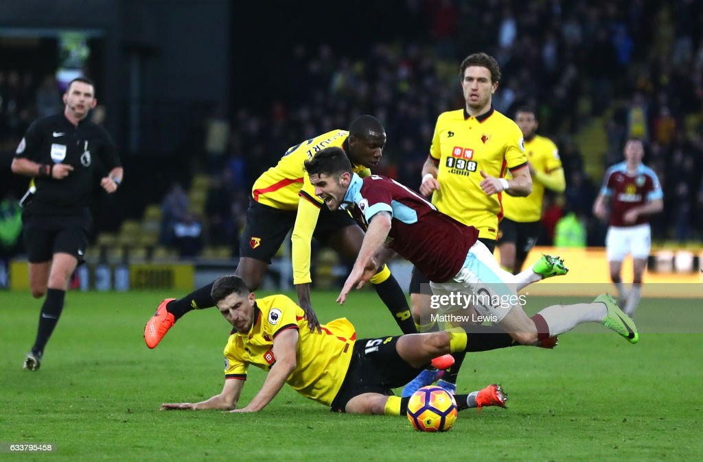 Craig Cathcart of Watford (L) tackles Robbie Brady of Burnley (R) during the Premier League match between Watford and Burnley at Vicarage Road on February 4, 2017 in Watford, England.