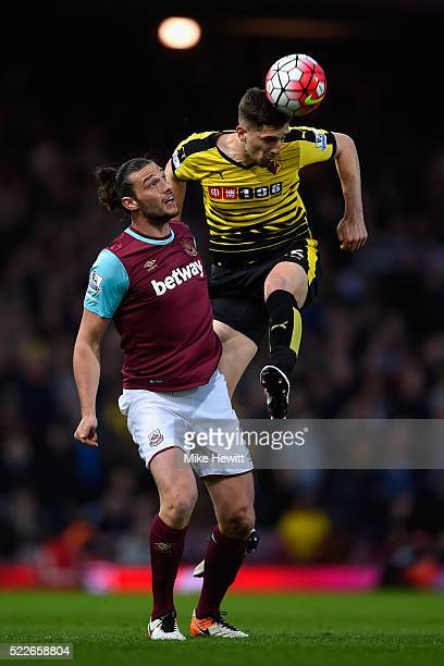 Craig Cathcart of Watford wins a header over Andy Carroll of West Ham United during the Barclays Premier League match between West Ham United and...