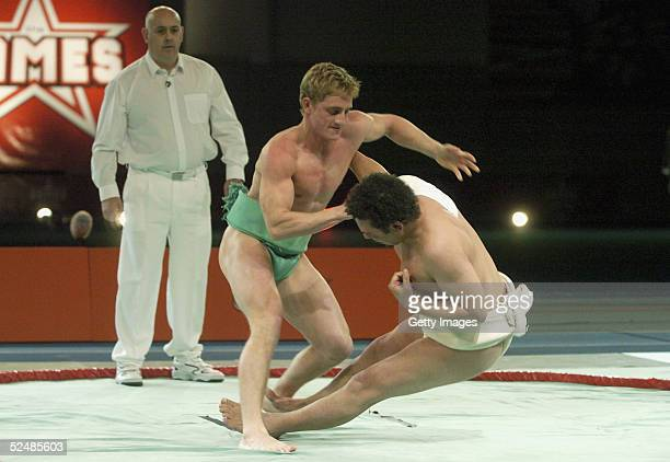 Craig Charles and Philip Olivier of the boys participate in the sumo wrestling Fina tournament on day three of the new series of the reality TV show...