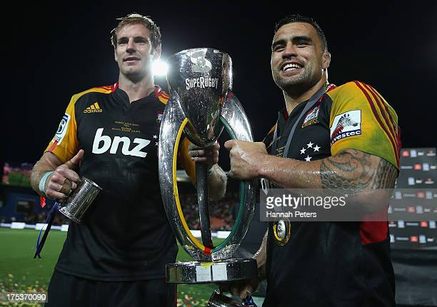 Craig Clarke and Liam Messam of the Chiefs celebrate with the trophy after winning the Super Rugby Final match between the Chiefs and the Brumbies at...
