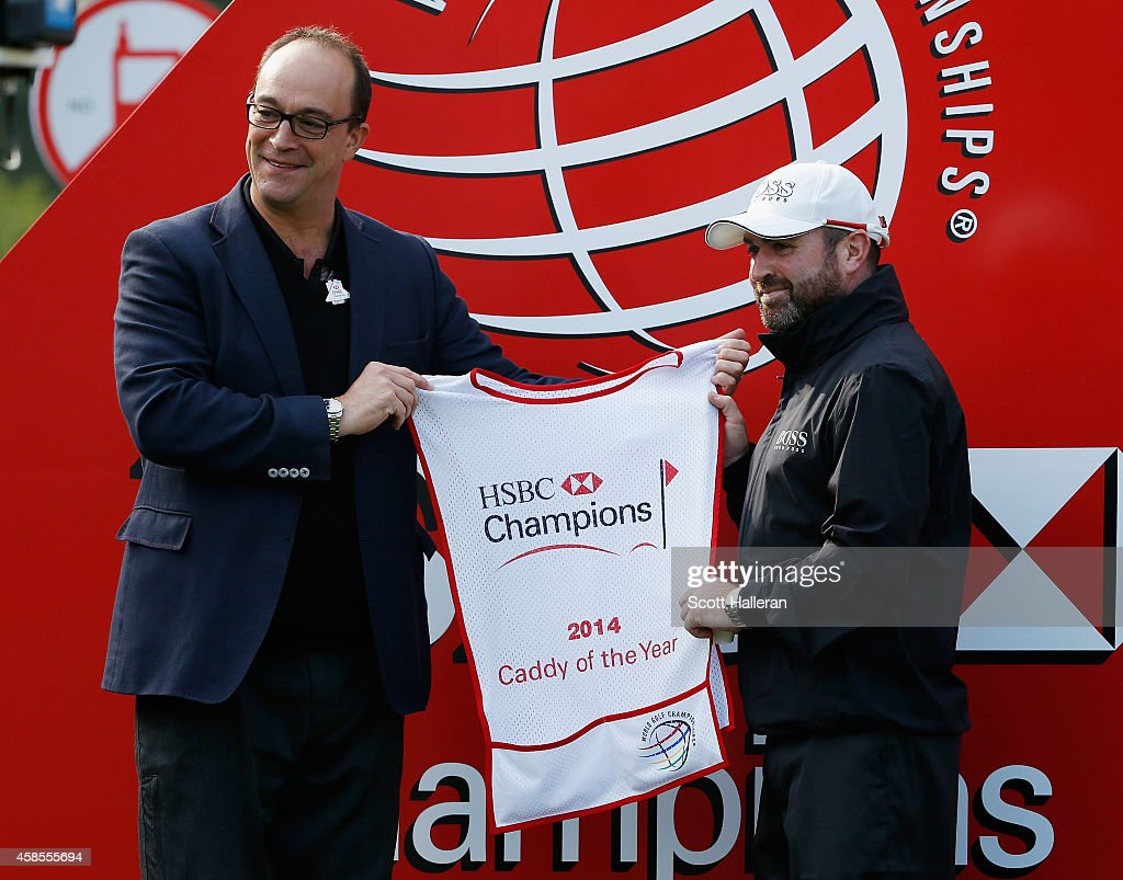 Craig Connelly receives a caddie bib from Giles Morgan, Group Head of Sponsorship HSBC, after being named the 2014 HSBC Caddy Of The Year during the second round of the WGC - HSBC Champions at the Sheshan International Golf Club on November 7, 2014 in Shanghai, China