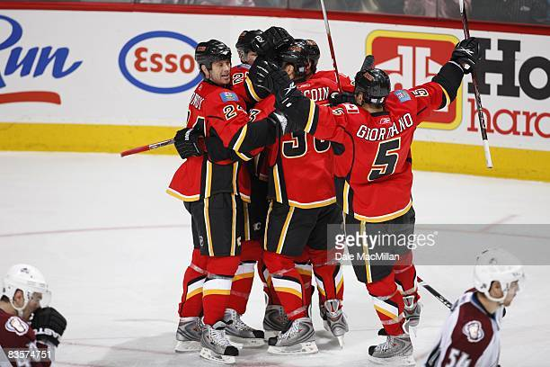 Craig Conroy and Mark Giordano of the Calgary Flames celebrate with teammates during the game against the Colorado Avalanche on October 28 2008 at...