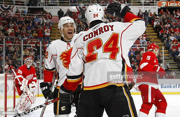 Craig Conroy of the Calgary Flames celebrates his first period goal against the Detroit Red Wings with teammate Jarome Iginla of the Calgary Flames...