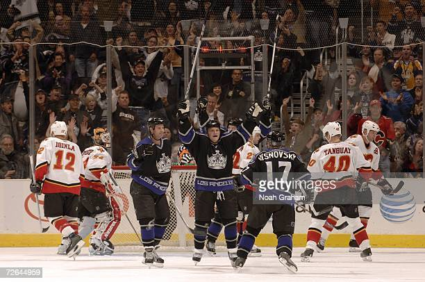 Craig Conroy Sean Avery and Lubomir Visnovsky of the Los Angeles Kings celebrate after Alexander Frolov scores a goal against the Calgary Flames on...