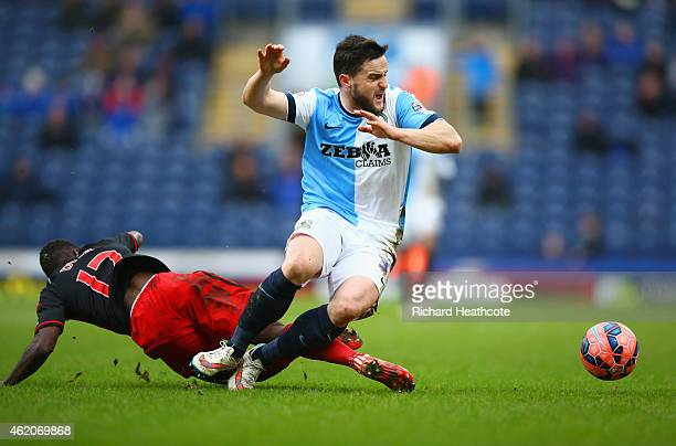Craig Conway of Blackburn Rovers battles with Nathan Dyer of Swansea City during the FA Cup Fourth Round match between Blackburn Rovers and Swansea...
