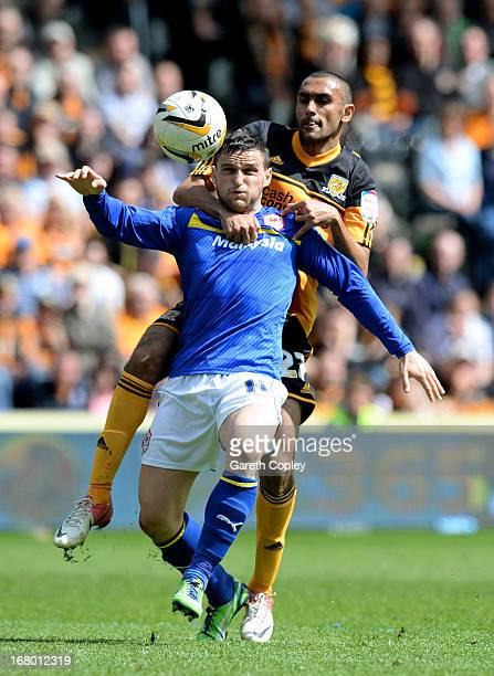 Craig Conway of Cardiff is challenged by Ahmed Elmohamady of Hull during the npower Championship match between Hull City and Cardiff City at KC...