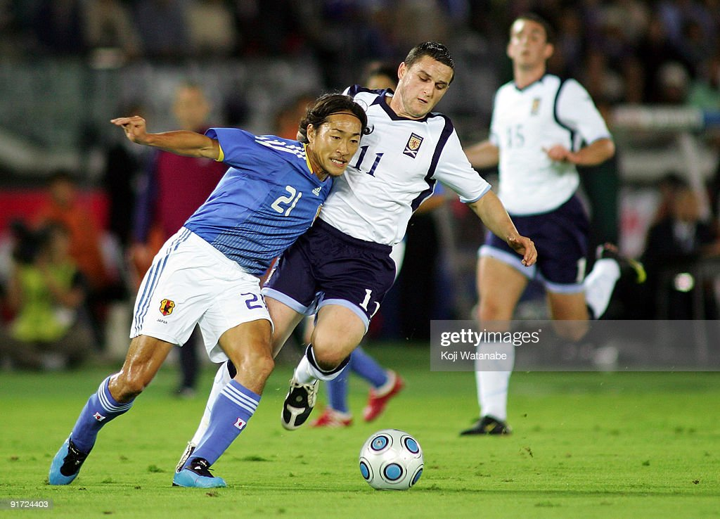 Craig Conway of Scotland and Naohiro Ishikawa of Japan compete for the ball during Kirin Challenge Cup 2009 match between Japan and Scotland at Nissan Stadium on October 10, 2009 in Yokohama, Japan.
