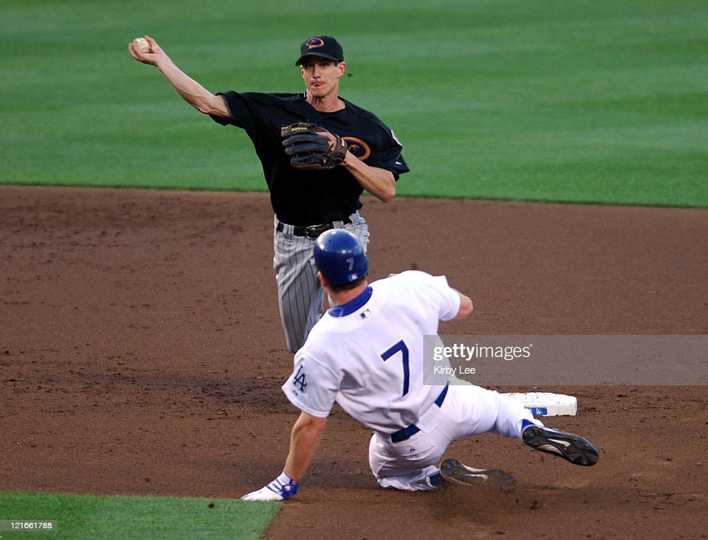 Craig Counsell of the Arizona Diamondbacks throws over J.D. Drew of the Los Angeles Dodgers to complete a double play during 10-3 victory at Dodger Stadium in Los Angeles, Calif. on Sunday, July 3, 2005.