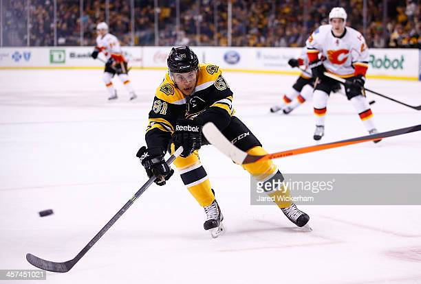 Craig Cunningham of the Boston Bruins tries to stop a pass in his NHL debut against the Calgary Flames in the first period at TD Garden on December...