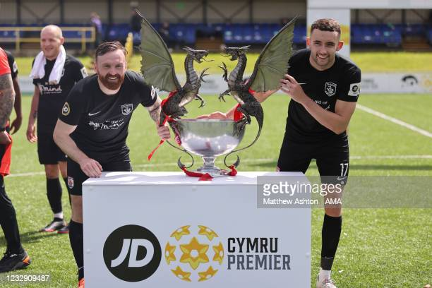 Craig Curran and Kris Owen hold the trophy as Connah's Quay Nomads celebrate being champions of the Welsh / Cymru Welsh Premier League during the...