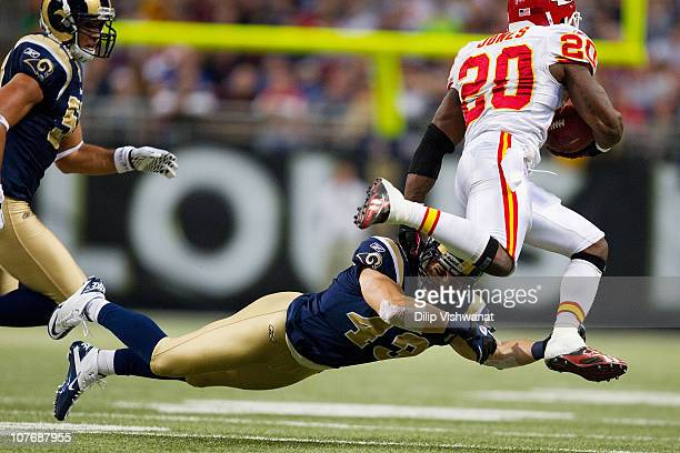 Craig Dahl of the St Louis Rams looks to tackle Thomas Jones of the Kansas City Chiefs at the Edward Jones Dome on December 19 2010 in St Louis...