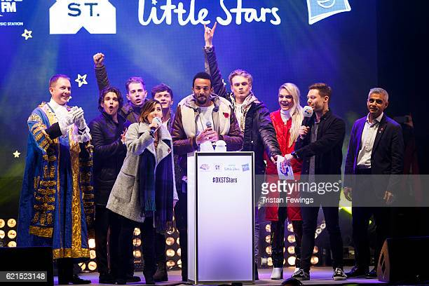 Craig David centre is joined on stage by the Lord Mayor of Westminster Steve Summers Bradley Simpson James McVey Amy Vivian Connor Ball Tristan Evans...