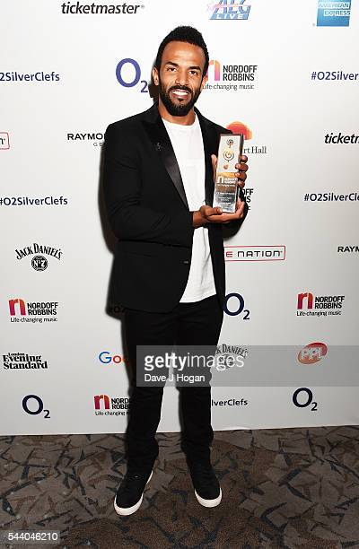 Craig David poses with the American Express Innovation Award during the Nordoff Robbins O2 Silver Clef Awards on July 1 2016 in London United Kingdom