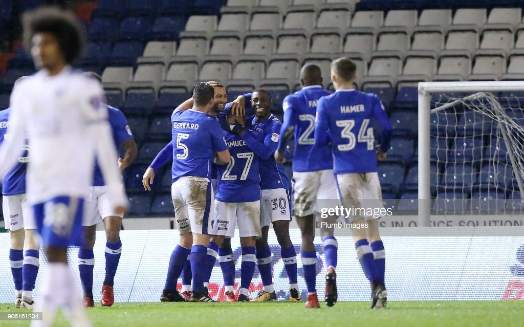 Craig Davies of Oldham Athletic celebrates with his team mates after scoring to make it 1-1 during the Checkatrade Trophy tie between Oldham Athletic and Leicester City at Boundary Park, on January 17th, 2018 in Oldham, United Kingdom