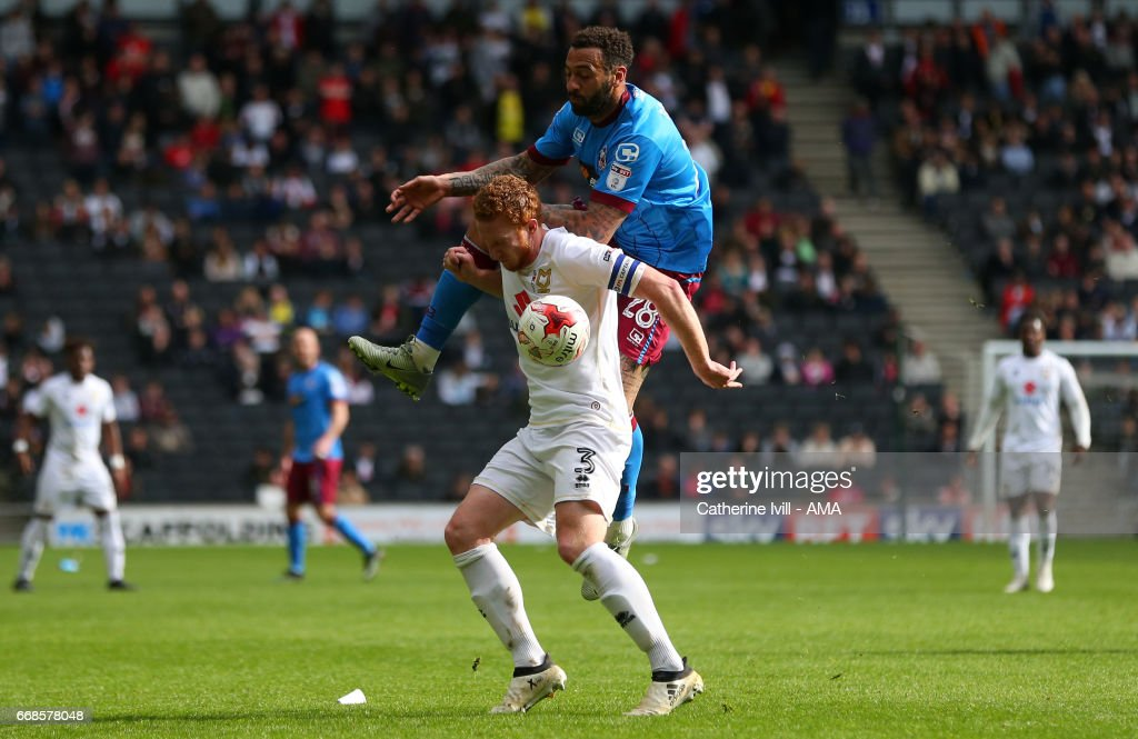 Craig Davies of Scunthorpe United and Dean Lewington of MK Dons during the Sky Bet League One match between MK Dons and Scunthorpe United at StadiumMK on April 14, 2017 in Milton Keynes, England.