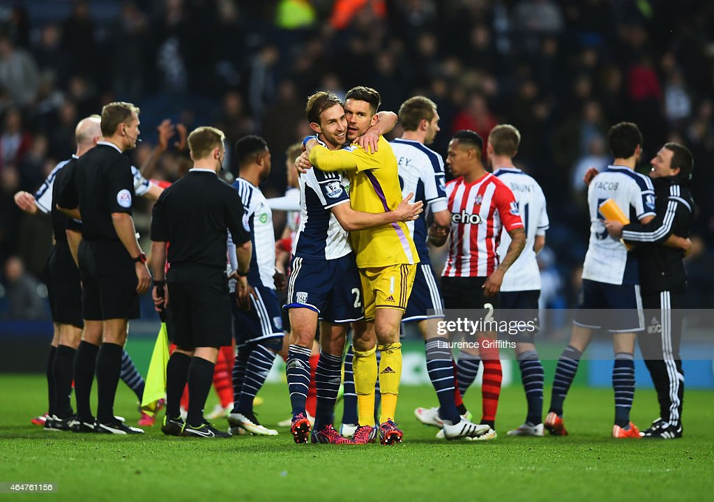 Craig Dawson and Ben Foster of West Bromwich Albion (1) embrace after the Barclays Premier League match between West Bromwich Albion and Southampton at The Hawthorns on February 28, 2015 in West Bromwich, England.