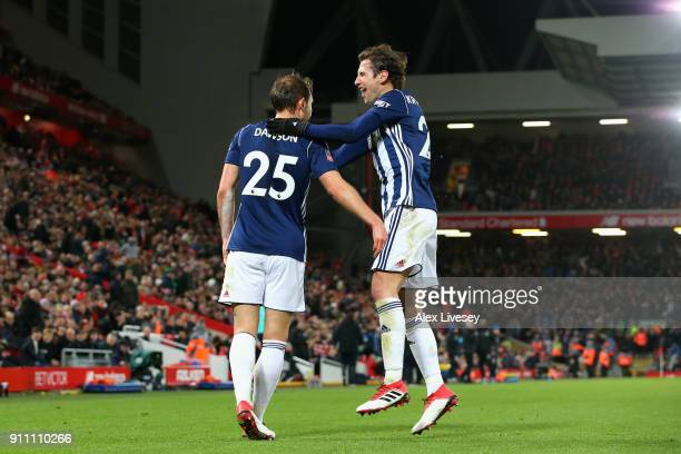 Craig Dawson and Grzegorz Krychowiak of West Bromwich Albion celebrate their third goal scored in his own net by Joel Matip of Liverpool during The...