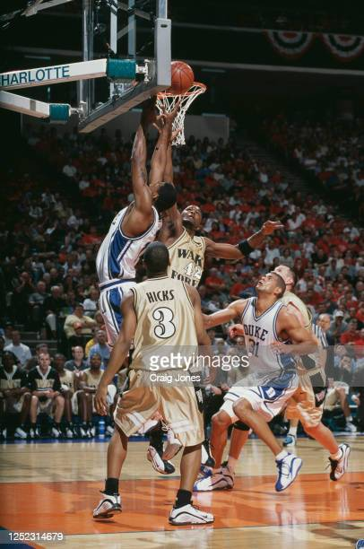 Craig Dawson, Guard for the Wake Forest Demon Deacons and Nate James of the Duke University Blue Devils reach for the ball from the rebound as...