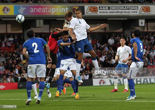 Craig Dawson of England wins the arial ball from team mate Jack Rodwell for the opening goal during the UEFA European Under-21 Championship Qualifier...