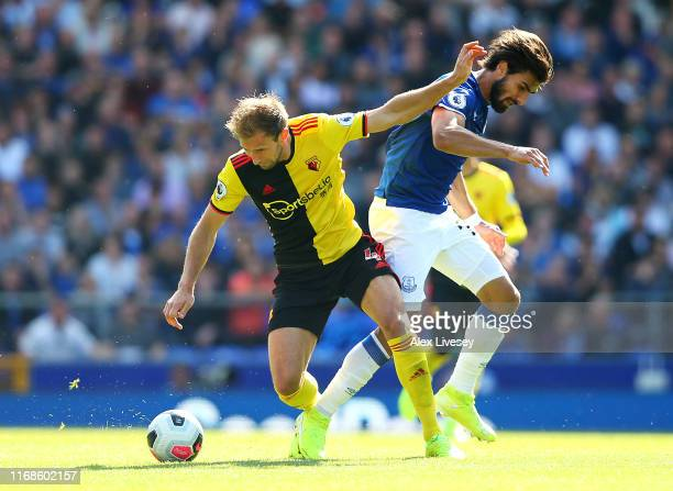 Craig Dawson of Watford battles for possession with Andre Gomes of Everton during the Premier League match between Everton FC and Watford FC at...