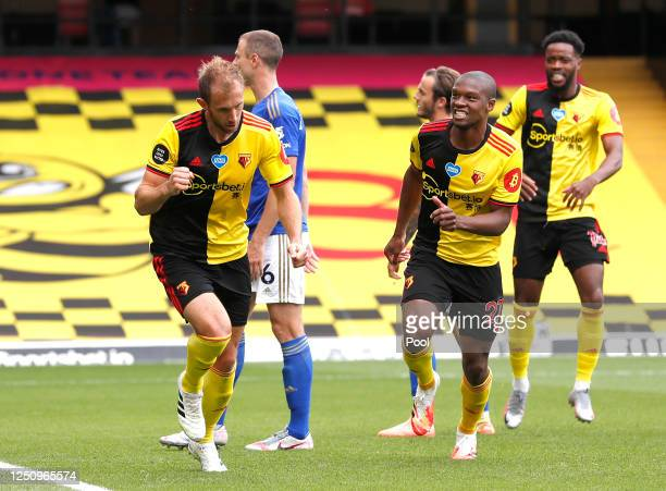 Craig Dawson of Watford celebrates after scoring his team's first goal during the Premier League match between Watford FC and Leicester City at...