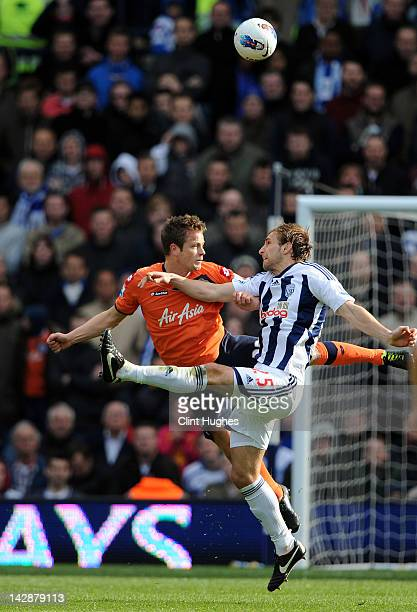 Craig Dawson of West Brom and Heidar Helguson of QPR compete for a header during the Barclays Premier League match between West Bromwich Albion and...