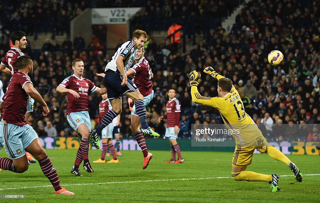 Craig Dawson of West Brom heads and scores the opening goal past Adrian of West Ham during the Barclays Premier League match between West Bromwich Albion and West Ham United at The Hawthorns on December 2, 2014 in West Bromwich, England.