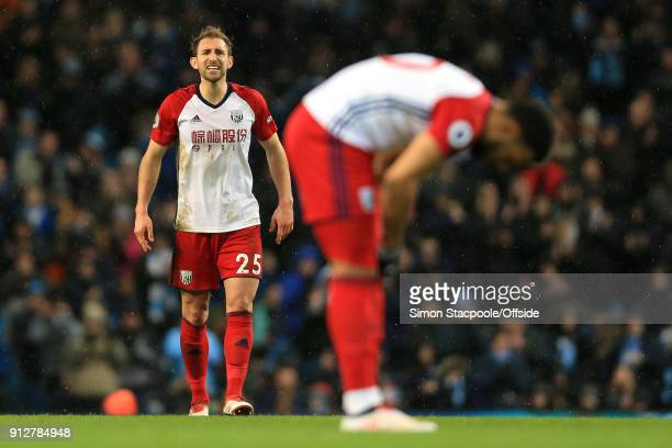 Craig Dawson of West Brom shouts at teammate Matt Phillips of West Brom during the Premier League match between Manchester City and West Bromwich...
