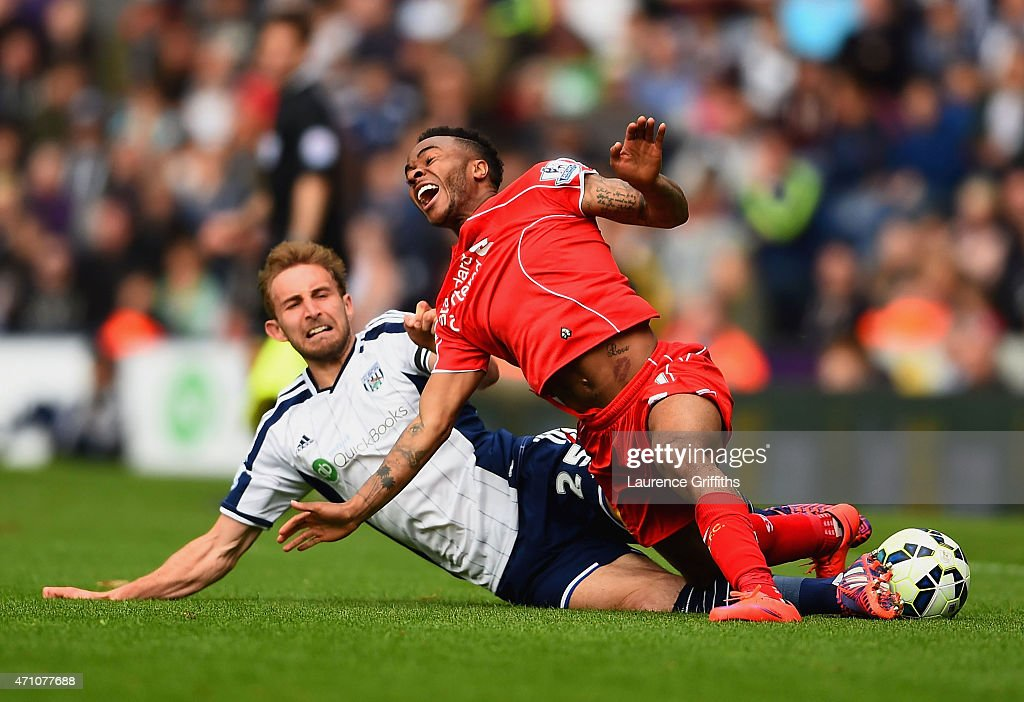 Craig Dawson of West Brom tackles Raheem Sterling of Liverpool during the Barclays Premier League match between West Bromwich Albion and Liverpool at The Hawthorns on April 25, 2015 in West Bromwich, England.
